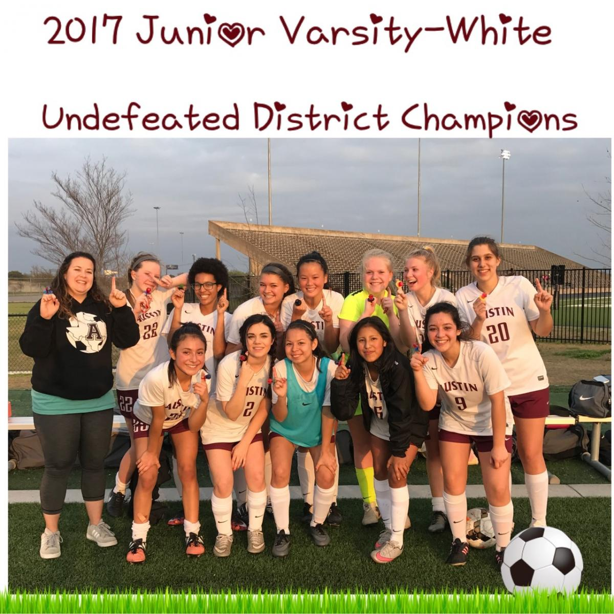 JV White Wins District