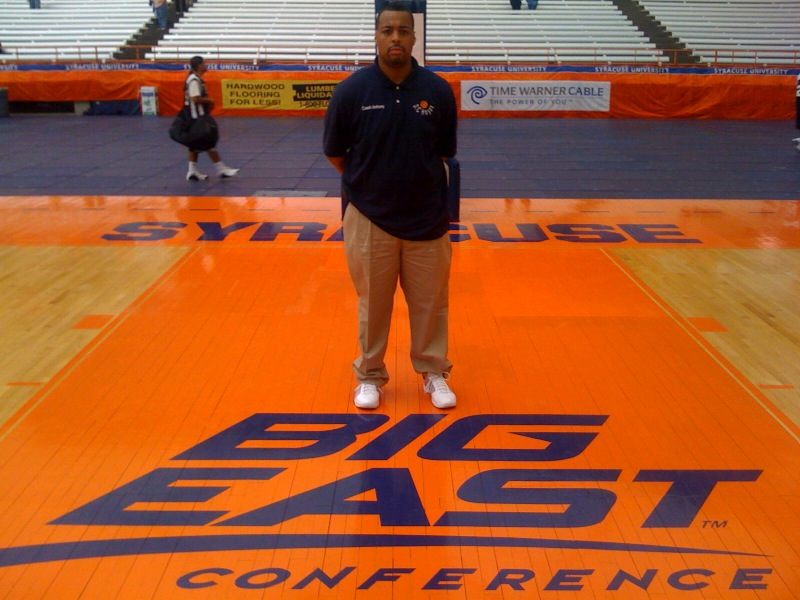 COACH ANTHONY ON THE TEAM FLOOR.