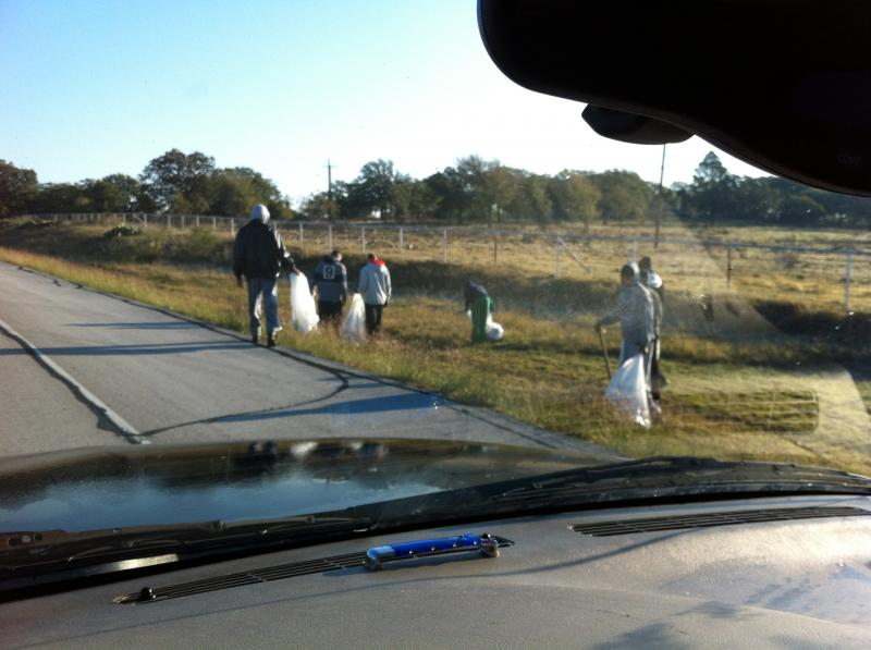 the team pickin up trash in the community...