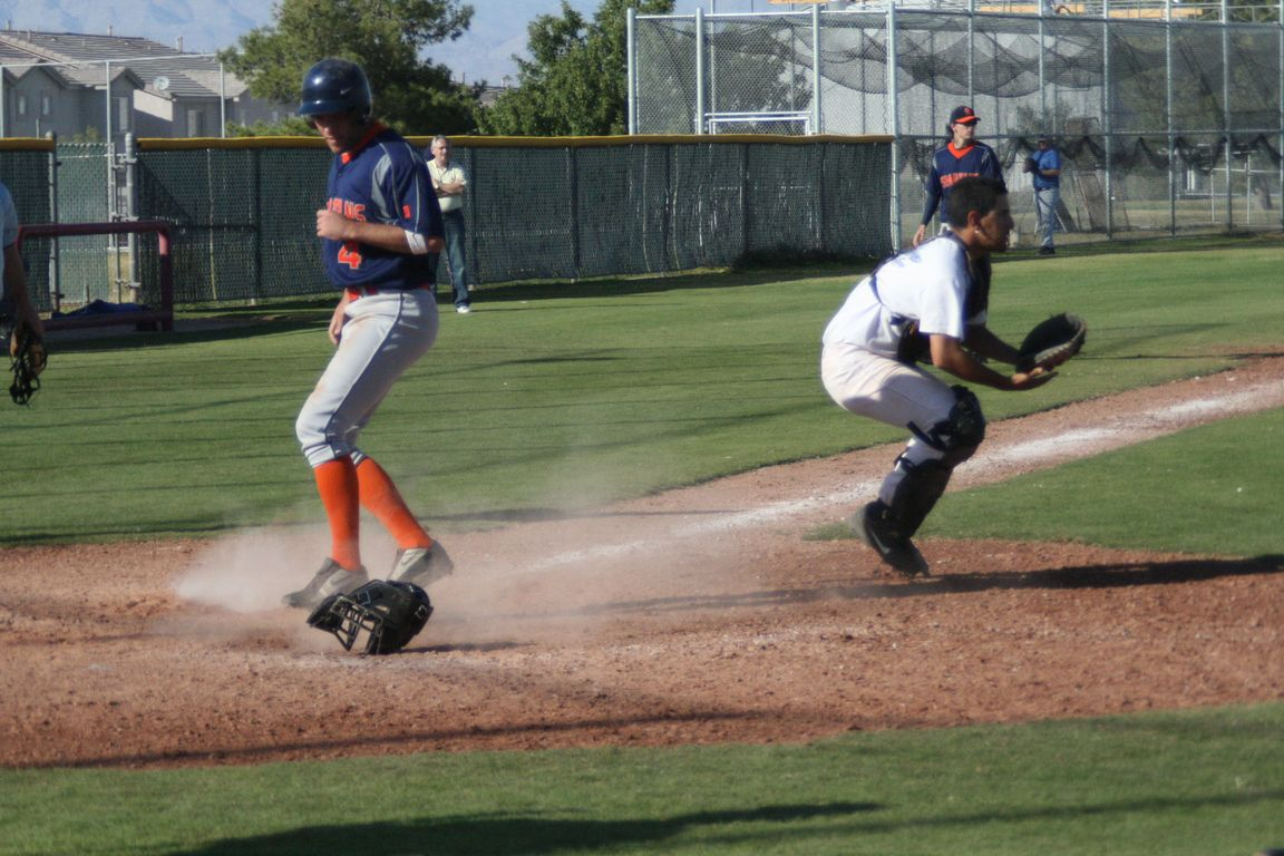 Stu-Bob sliding home to make it 3 to 0